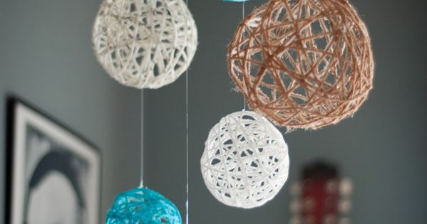Yarn Ball Mobile - Make a solution of glue and water. Wet