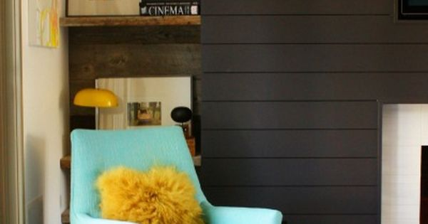 Turquoise chair makes a big impact against the dark walls, Hmmmm Lovely!