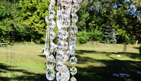 Would make a really pretty, really creative wind chime, too. A Watering Can That Pours Crystals hanging out in the back yard off of a beautiful tree. (such a dreamer)