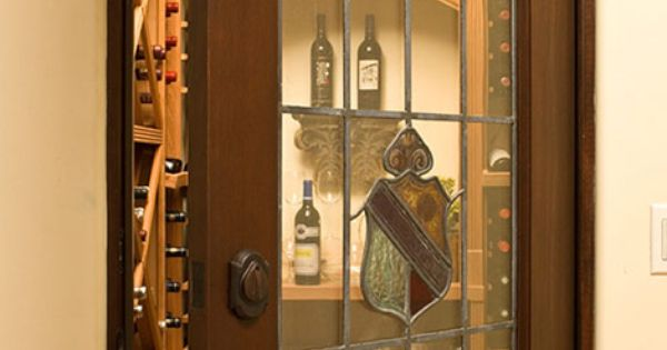 A finished basement level includes a walk in wine cellar for Walk in wine cellars