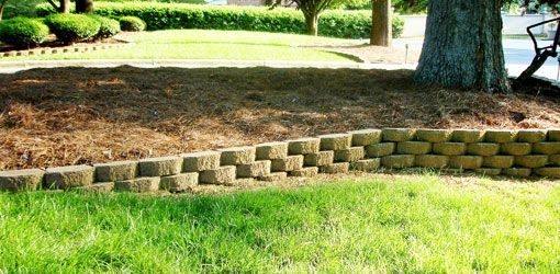 Arizona landscaping small yard with downward slope how - How to build a garden retaining wall ...