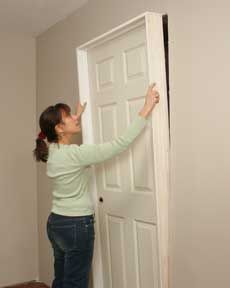 How To Install A Door Hometips Interior Door Installation Prehung Interior Doors Diy Interior Doors