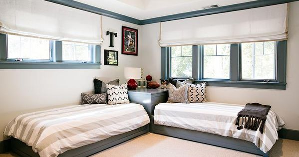Contemporary Boys Bedroom Features Gray Beds Dressed In White And