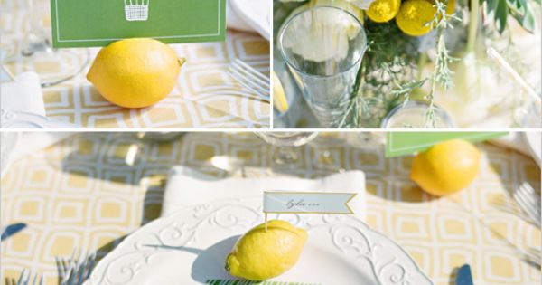 lemons used as escort cards and table number holders - great for