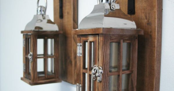 Wood And Glass Lantern Pair On Stained Knotty Pine Boards