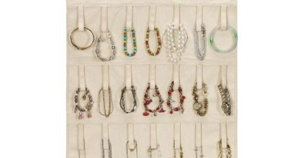 Hanging jewelry organizer with loops for 21 necklaces and 14 bracelets. Product: