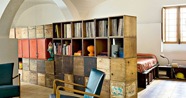 Old crates as room divider for studio apartment