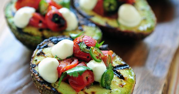 EAT CLEAN. Grilled avocado stuffed with caprese salad, cilantro and jalapeno.