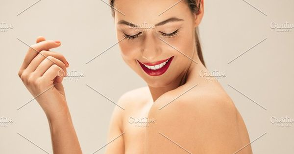 Portrait of pretty young woman posing topless. Close up studio shot of caucasian female model with healthy skin.