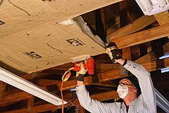 Stapling Insulation To Garage Roof Trusses Garage Insulation Garage Ceiling Insulation Garage Renovation