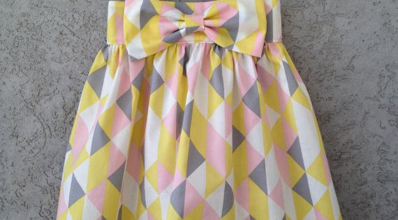 fresh and modern triangle geometric print dress in yellow, pink, grey, and