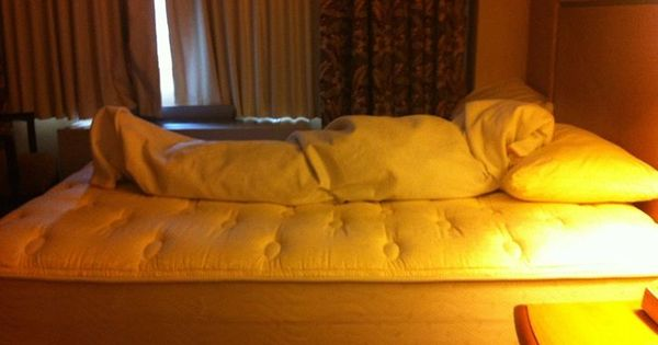 DIY-Dirty Trick-Roll up bed sheets and blankets to make it ...