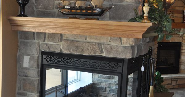 Stoned Fireplace With See Through Fireplace And Crown Oak