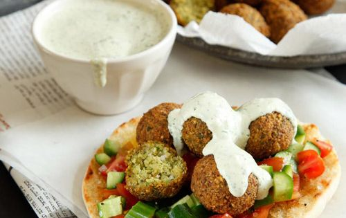 pita with tomatoes and cucumbers, falafel and tahini (all veggie ...
