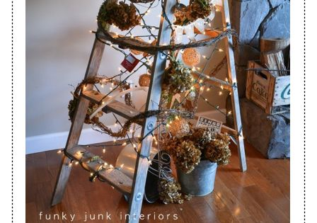 A treeless ladder Christmas tree, decorated with twig garland and hydrangeas, by