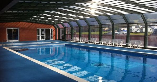 Covered outdoor heated swimming pool dorset poolside for Heated garden swimming pools