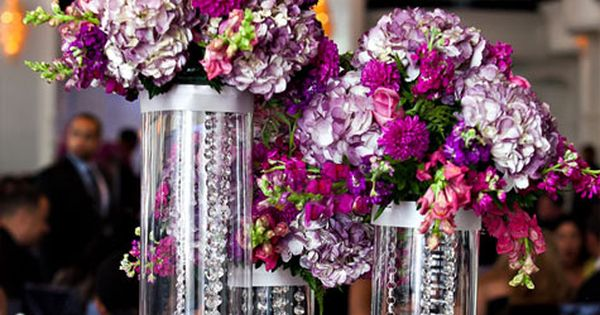 Hanging Crystal Centerpieces Groups of cylinders filled with hanging crystals and topped