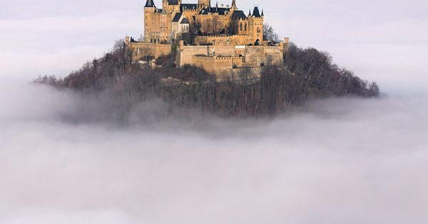 Castle in Germany floating above the clouds . hohenzollern castle