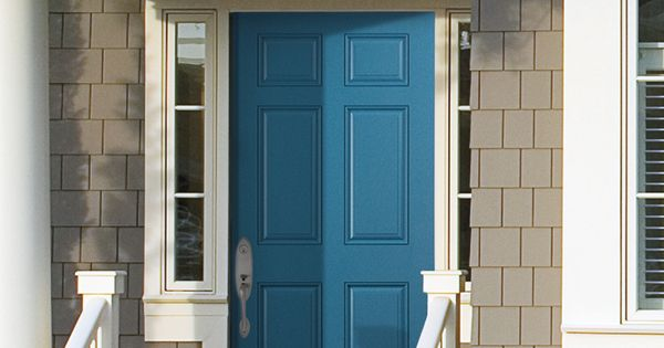A Peacock Blue Front Door Is A Lively Welcome To Guests