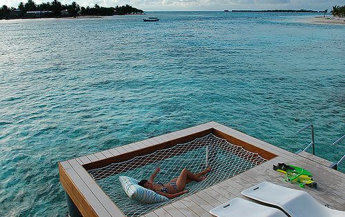 Built-in hammock in the deck over the water. Dream House