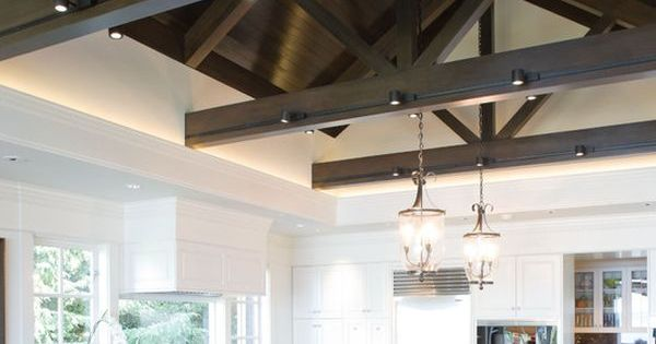 32 Cool And Functional Track Lighting Ideas: 04 Large Kitchen With Dark Wooden Beams And Track Lights