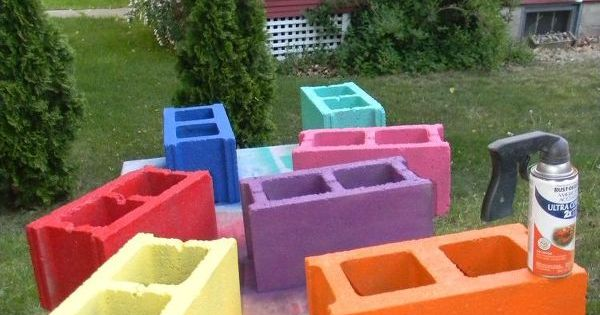 See how to stack a colorful row of cinder blocks to for Cinder block seating area