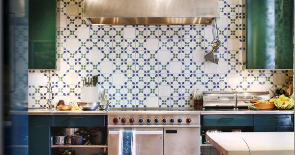 patterned tiled kitchen backsplash & dark green cabinets