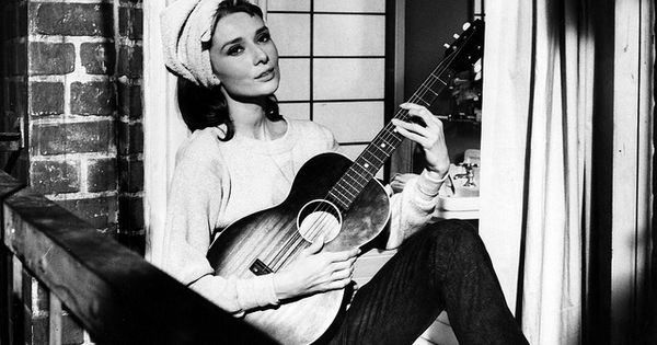 She is stunning... Wish I was her.. (and couple play guitar) audreyhepburn