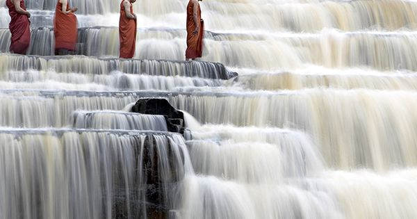 A beautiful photo of Monks at Pongour Falls, Vietnam