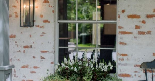 Fixer upper old world charm for newlyweds bricks for Window world waco