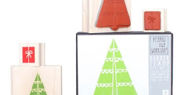 Two christmas themed rubber stamps, a Christmas tree and a present themed stamp.