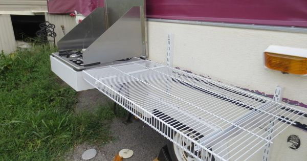 Removable shelf on outside of the camper so you don't have to