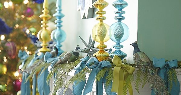 Hang ornaments from ribbons on the mantle~~traditional Christmas colors could be used
