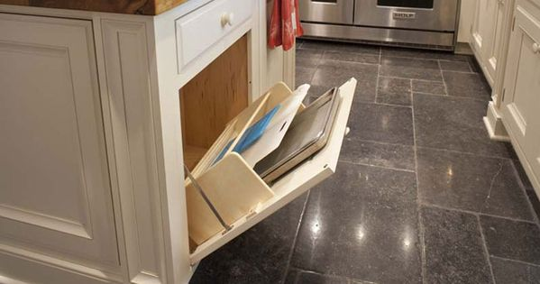 Base cabinet or kitchen island with tilt-out storage for cutting boards, cookie