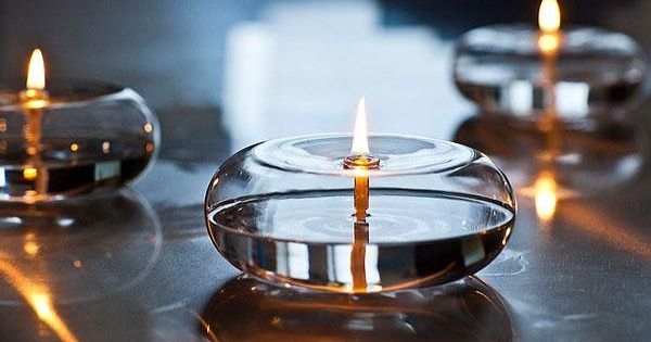Glass encapsulated oil candles
