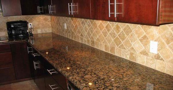 baltic brown granite countertops with light tan backsplash would