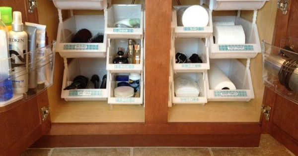 These dollar store stacking bins are the perfect size for bathroom cabinet