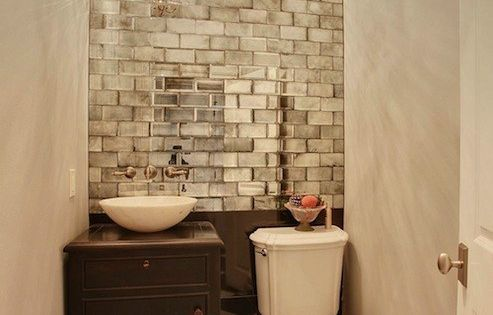 small space, mirrored subway tiles, accent wall. This is beautiful! (I want