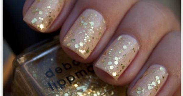 Golden glitter on Nude nail polish
