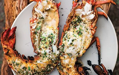 Grilled Lobster with Garlic-Parsley Butter _ In this recipe, lobster is flash-grilled,
