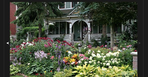 Colorful Flower Garden Surrounding a Queen Anne Victorian ...