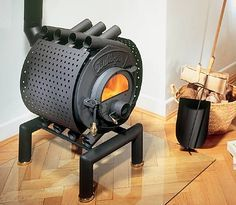 These Unique Wood Burning Stoves Are Handcrafted In Germany And Have Simple Yet Very Effective Design The Wood Burning Stove Wood Heater Wood Stove Fireplace