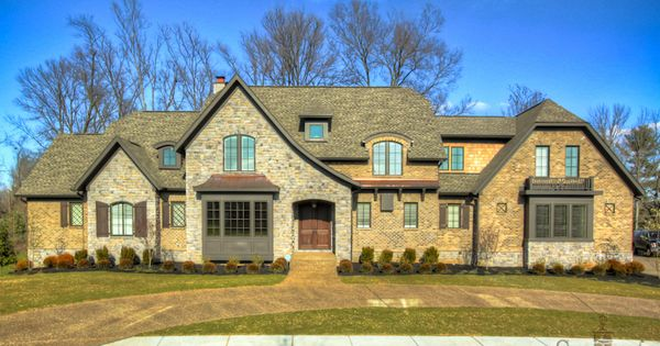 Rustic brick and stone exterior with copper accents for Brick and stone elevations