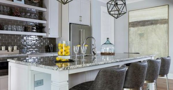 Gray Granite Countertop Is A True Statement Of Class In This Beautiful White Kitchen The Island With Legs Brown Kitchen Cabinets Countertops Cabinets Countertops Stools For Kitchen Island