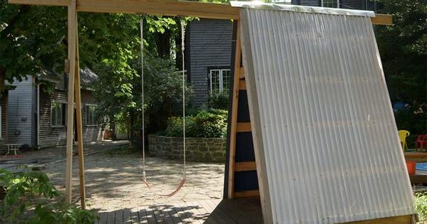 Build a combination swing set playhouse and climbing wall