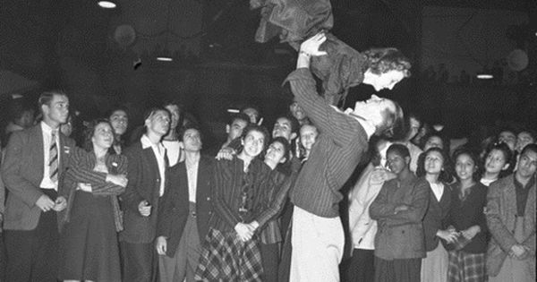 Crowd watching a couple dance in Jitterbug Dance contest Los Angeles, Calif,