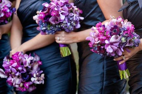purple bridesmaid bouquets looks amazing with the navy dresses.. I never thought