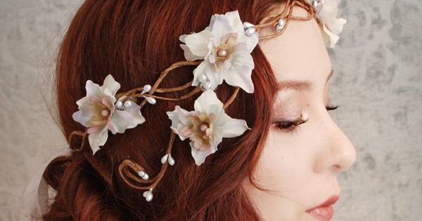 I LOVE this girls head pieces! Forget just for weddings, I want
