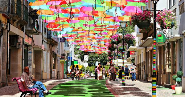 SO PRETTY!! Umbrella covered walkway in Agueda, Portugal - sunny day lights