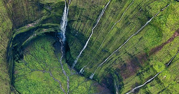 "Photographed by Leona Boyd ~ ""Kauai's Mount Waialeale; generally considered the rainiest"